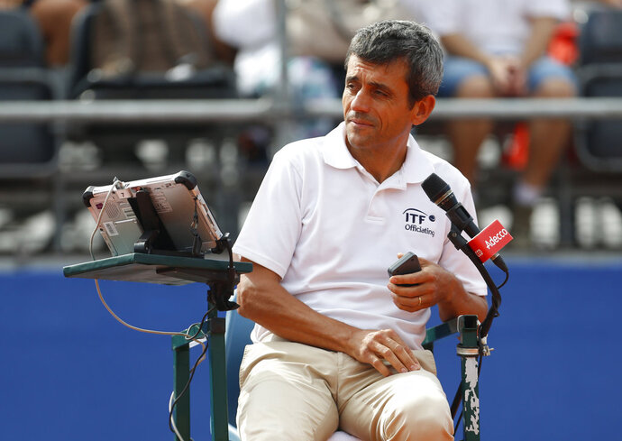 Tennis umpire Carlos Ramos gets ready to officiate the Frances Tiafoe of the United States, against Marin Cilic, in a Davis Cup semifinal singles match between Croatia and the United States in Zadar, Croatia, Friday, Sept. 14, 2018. (AP Photo/Darko Bandic)