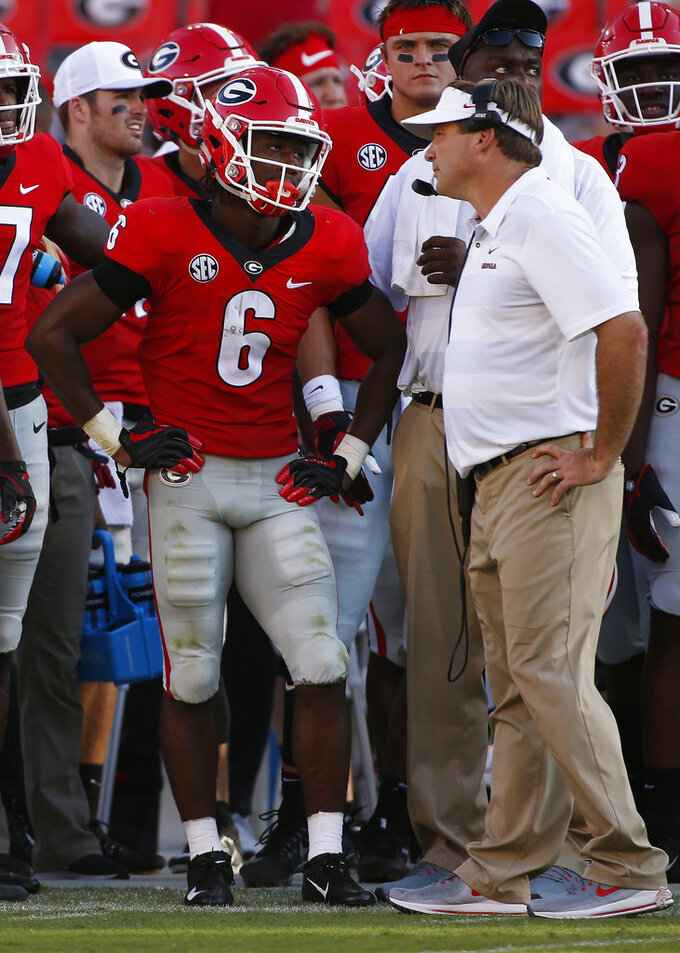 Georgia running back James Cook (6) speaks with Georgia coach Kirby Smart and getting called for a targeting penalty during the first half of an NCAA college football game against Austin Peay in Athens, Ga., Saturday, Sept. 1, 2018. (Joshua L. Jones/Athens Banner-Herald via AP)