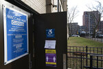 A vaccination center at the Abraham Lincoln High School is closed, Thursday, Jan. 21, 2021 in New York. Officials say about 15 New York City-run COVID-19 vaccination hubs are postponing all first-dose appointments and other sites have stopped making new appointments as the city waits for more vaccine supplies. (AP Photo/Mark Lennihan)