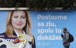 A man walks past a campaign poster for Zuzana Caputova in Bratislava, Slovakia, Friday, March 15, 2019. Caputova is one of the favorite candidates to succeed Slovakia's President Andrej Kiska in the upcoming election. Slovakia holds the presidential election on Saturday, March 16, 2019. The poster reads: