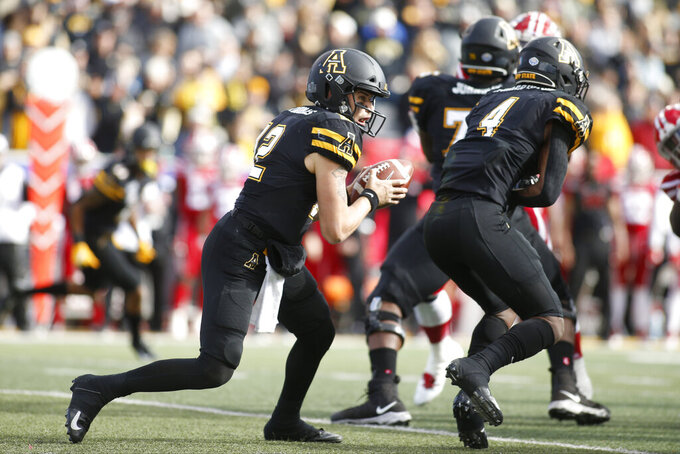 Appalachian State quarterback Zac Thomas (12) runs a play against Louisiana-Lafayette during the first half of an NCAA college football game in the Sun Belt Football Championship on Saturday, Dec. 7, 2019, in Boone, N.C. (AP Photo/Brian Blanco)