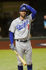 Los Angeles Dodgers' Chris Taylor reacts after striking against the Atlanta Braves during the third inning in Game 5 of a baseball National League Championship Series Friday, Oct. 16, 2020, in Arlington, Texas. (AP Photo/Eric Gay)
