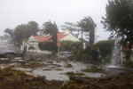 Debris blocks a road in the seafront village of Feteira, outside Horta, in the Portuguese island of Faial, Wednesday, Oct. 2, 2019. Hurricane Lorenzo is lashing the mid-Atlantic Azores Islands with heavy rain, powerful winds and high waves. The Category 2 hurricane passed the Portuguese island chain Wednesday. (AP Photo/Joao Henriques)