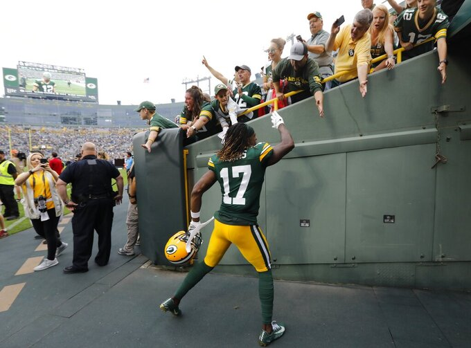 Green Bay Packers' Davante Adams greets fans after an NFL football game against the Minnesota Vikings Sunday, Sept. 15, 2019, in Green Bay, Wis. The Packers won 21-16. (AP Photo/Mike Roemer)