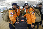 South Korean rescue team members prepare to board a plane to leave for Budapest at Incheon International Airport in Incheon, South Korea, Thursday, May 30, 2019. A massive search is underway on the Danube River in downtown Budapest for over a dozen people missing after a sightseeing boat with 33 South Korean tourists sank after colliding with another vessel during an evening downpour. (AP Photo/Ahn Young-joon)