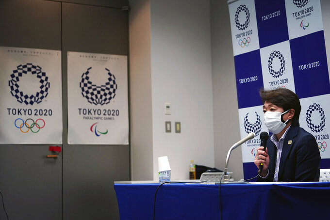 Seiko Hashimoto, president of the Tokyo 2020 Organizing Committee of the Olympic and Paralympic Games, speaks during a press conference Friday, March 19, 2021, in Tokyo. (AP Photo/Eugene Hoshiko, Pool)