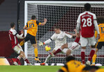 Wolverhampton Wanderers' Daniel Podence, second left, scores his team's second goal during the English Premier League soccer match between Arsenal and Wolverhampton Wanderers at Emirates Stadium, London, Sunday, Nov. 29, 2020. (Catherine Ivill/Pool via AP)