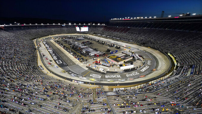 Drivers circle the track during a NASCAR Xfinity Series auto race at Bristol Motor Speedway Friday, Sept. 17, 2021, in Bristol, Tenn. (AP Photo/Mark Humphrey)