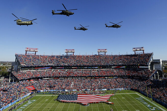 Helicopters fly over Nissan Stadium as part of a Salute to Service military appreciation pregame ceremony before an NFL football game between the Tennessee Titans and the Kansas City Chiefs Sunday, Nov. 10, 2019, in Nashville, Tenn. (AP Photo/James Kenney)