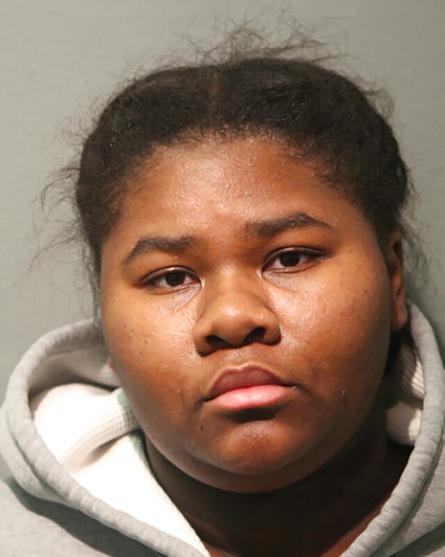This booking photo released by the Chicago Police Department shows Jessica Hill, 21, one of two sisters accused of stabbing a West Side Chicago store security guard 27 times with a knife after he asked them to wear face masks and use hand sanitizer on Sunday, Oct. 25, 2020. They were ordered held without bond on Tuesday, Oct. 27. (Chicago Police Department via AP)