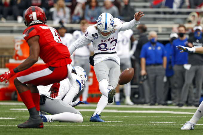 Kansas' Jacob Borcila (83) kicks a field goal during the first half of an NCAA college football game Saturday, Dec. 5, 2020, in Lubbock, Texas. (AP Photo/Brad Tollefson)