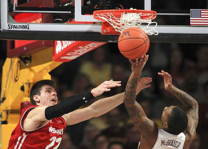 Minnesota guard Dupree McBrayer (1) shoots next to Wisconsin forward Ethan Happ (22) during the second half of an NCAA college basketball game Wednesday, Feb. 6, 2019, in Minneapolis. Wisconsin won 56-51. (AP Photo/Andy Clayton-King)