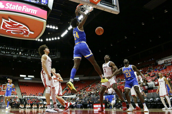 UCLA guard Jalen Hill (24) dunks during the second half of the team's NCAA college basketball game against Washington State in Pullman, Wash., Wednesday, Jan. 30, 2019. UCLA won 87-67. (AP Photo/Young Kwak)