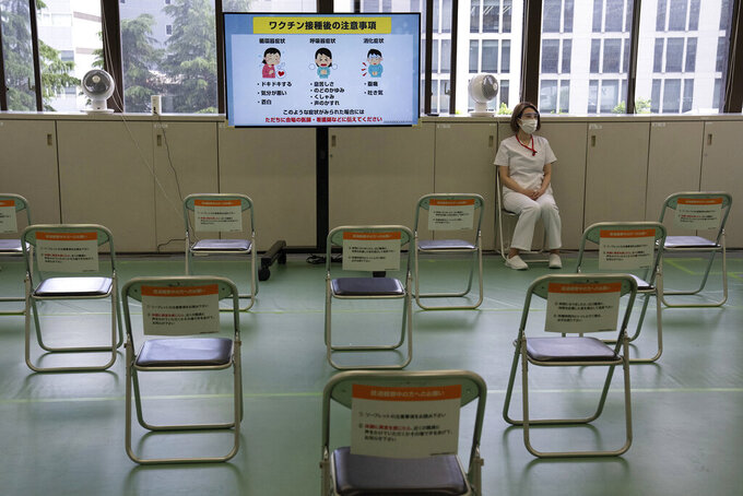 A nurse waits in an observation room to watch for adverse effects in people who have just received the Moderna coronavirus vaccine at the newly-opened mass vaccination center in Tokyo Monay, May 24, 2021.  Japan opened mass-vaccination sites in two of the country's biggest metropolitan areas, Tokyo and Osaka, with the goal of administering the shots to up to 15,000 elderly people a day. (Carl Carl Court/Pool Photo via AP)