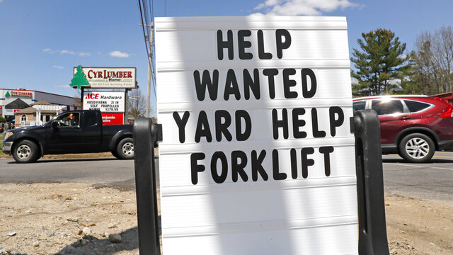 A help wanted sign is posted outside Cyr Lumber in Windham, N.H., Thursday, May 7, 2020. Roughly 33.5 million people have now filed for jobless aid in the seven weeks since the coronavirus began forcing millions of companies to close their doors and slash their workforces. (AP Photo/Charles Krupa)