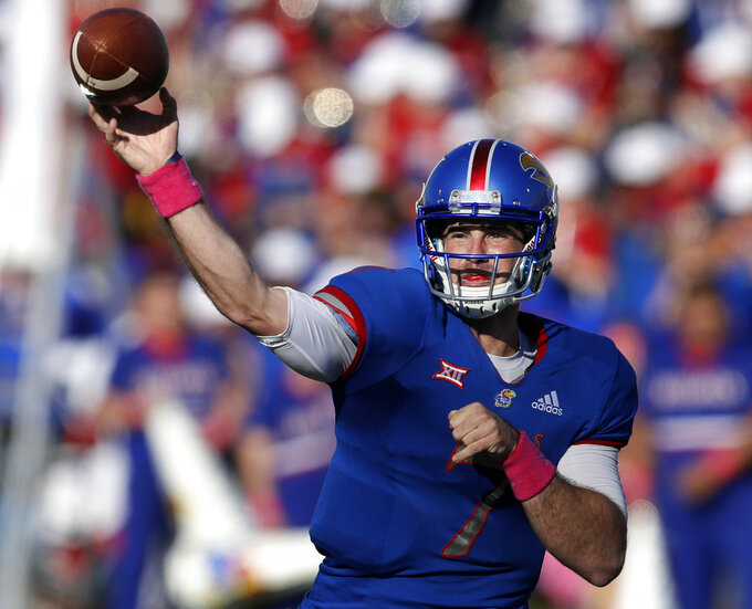 FILE - In this Oct. 27, 2018, file photo, Kansas quarterback Peyton Bender (7) passes during the second half of an NCAA college football game against TCU, in Lawrence, Kan. Bender had heard all the criticism about him. About the Jayhawks. About his coach. But with a gutsy performance against TCU last week, the Kansas quarterback finally quieted the critics _ at least for a week.  (AP Photo/Orlin Wagner, File)