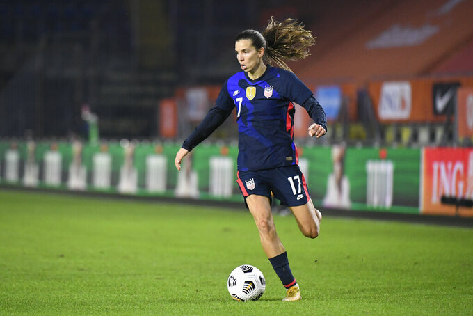FILE - In this Friday Nov. 27, 2020 file photo, United States' Tobin Heath plays the ball during their international friendly women's soccer match against The Netherlands at the Rat Verlegh stadium in Breda, Netherlands. United States international Tobin Heath is staying in English soccer. The 33-year-old forward has signed for Arsenal in the Women's Super League on Friday, Sept. 3, 2021. She played at Manchester United last season. (Piroschka van de Wouw/Pool via AP, file)