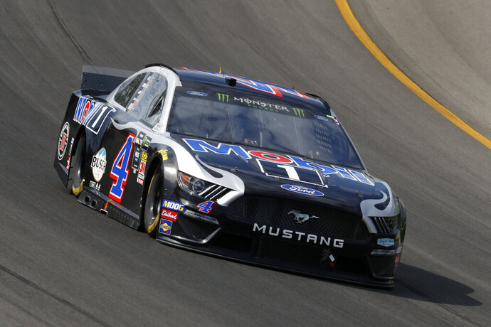 Kevin Harvick races out of turn one during a NASCAR Cup Series auto race at Michigan International Speedway in Brooklyn, Mich., Sunday, Aug. 11, 2019. (AP Photo/Paul Sancya)
