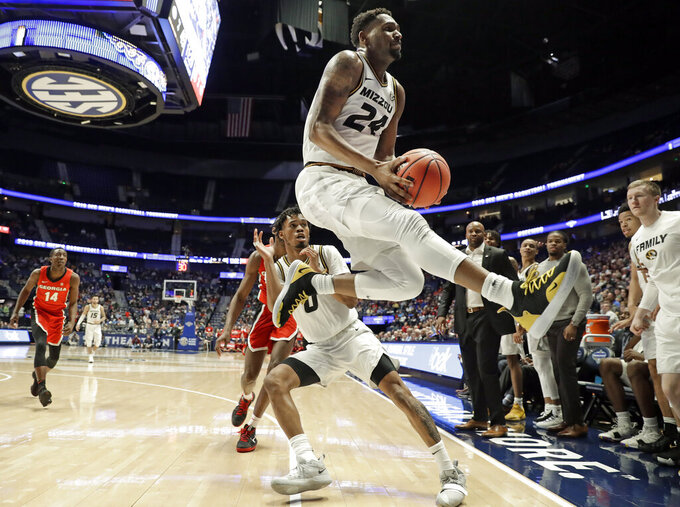 Missouri forward Kevin Puryear (24) keeps the ball from going out of bounds in the second half of an NCAA college basketball game against Georgia at the Southeastern Conference tournament, Wednesday, March 13, 2019, in Nashville, Tenn. Missouri won 71-61. (AP Photo/Mark Humphrey)