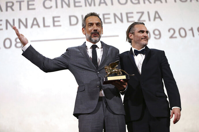 Director Todd Phillips, left, holds the Golden Lion for Best Film for 'Joker', joined by lead actor Joaquin Phoenix at the closing ceremony of the 76th edition of the Venice Film Festival, Venice, Italy, Saturday, Sept. 7, 2019. (Photo by Joel C Ryan/Invision/AP)