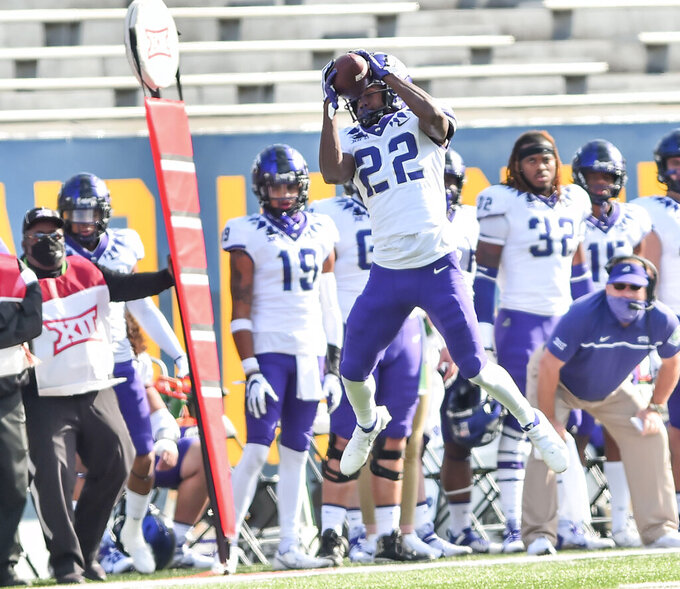 TCU wide receiver Blair Conwright (22) makes a catch against West Virginia during the second half of an NCAA college football game on Saturday, Nov. 14, 2020, in Morgantown, W.Va. (William Wotring/The Dominion-Post via AP)