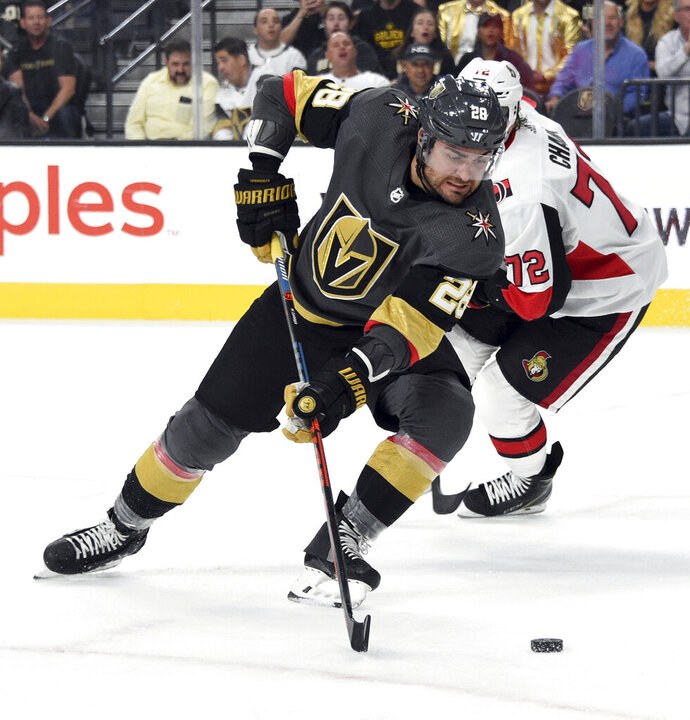 Vegas Golden Knights left wing William Carrier (28) skates with the puck against Ottawa Senators defenseman Thomas Chabot during the second period of an NHL hockey game Thursday, Oct. 17, 2019, in Las Vegas. (AP Photo/David Becker)
