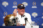 Notre Dame head coach Brian Kelly responds to questions during a news conference at AT&T Stadium in Arlington, Texas, Monday, Dec. 24, 2018. Notre Dame is scheduled to play Clemson in the NCAA Cotton Bowl semi-final playoff Saturday. (AP Photo/Jim Cowsert)