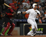 Houston Astros' Michael Brantley watches his two-run home run off Los Angeles Angels starting pitcher Dillon Peters during the first inning of a baseball game, Saturday, Aug. 24, 2019, in Houston. (AP Photo/Eric Christian Smith)