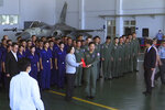 Taiwan President Tsai Ing-wen, center left, poses for photos with airmen near a Taiwan Indigenous Defense Fighter (IDF) jet displayed during a visit to the Penghu Magong military air base in outlying Penghu Island, Taiwan Tuesday, Sept. 22, 2020. Tsai visited the military base on one of Taiwan's outlying islands Tuesday in a display of resolve following a recent show of force by rival China. (AP Photo/Johnson Lai)