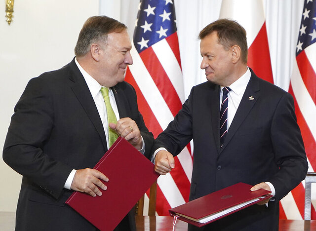 US Secretary of State Mike Pompeo, left, and Poland's Minister of Defence Mariusz Blaszczak greet each other after signing the US-Poland Enhanced Defence Cooperation Agreement in the Presidential Palace in Warsaw,  Poland, Saturday Aug. 15, 2020. Pompeo is on a five day visit to central Europe. (Janek Skarzynski/Pool via AP)