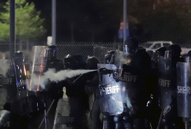 Shelby County Sheriff's deputies pepper spray a crowd of demonstrators advancing on the Hernando Desoto Bridge in Memphis, Tennessee, early Monday, June 1, 2020, as they protest the death of George Floyd in Minneapolis police custody May 25, 2020. (Daily Memphian via AP)