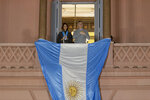 President Mauricio Macri and his wife Juliana Awada smile from the government house during a march in his support, in Buenos Aires, Argentina, Saturday, Aug. 24, 2019. Following a social media campaign large numbers of people gathered in the center of Buenos Aires to show their support for Macri's administration. (AP Photo/Tomas F. Cuesta)