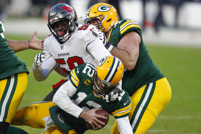 Tampa Bay Buccaneers' Shaquil Barrett (58) sacks Green Bay Packers quarterback Aaron Rodgers (12) during the second half of the NFC championship NFL football game in Green Bay, Wis., Sunday, Jan. 24, 2021. (AP Photo/Matt Ludtke)
