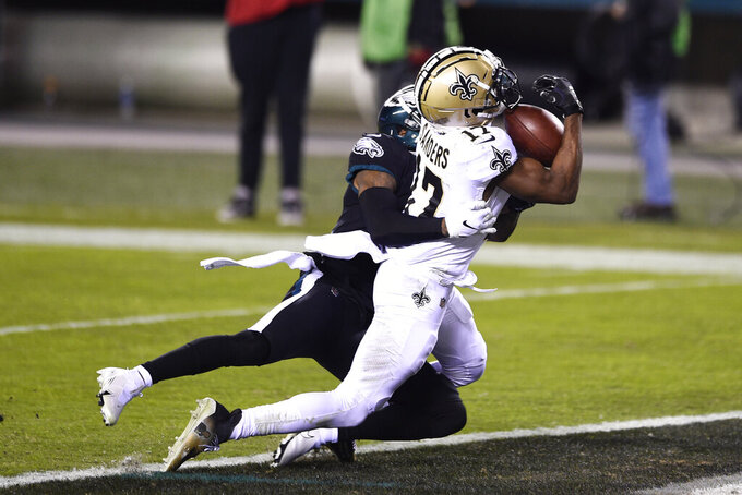 New Orleans Saints' Emmanuel Sanders, right, catches a touchdown against Philadelphia Eagles' Kevon Seymour during the second half of an NFL football game, Sunday, Dec. 13, 2020, in Philadelphia. (AP Photo/Derik Hamilton)