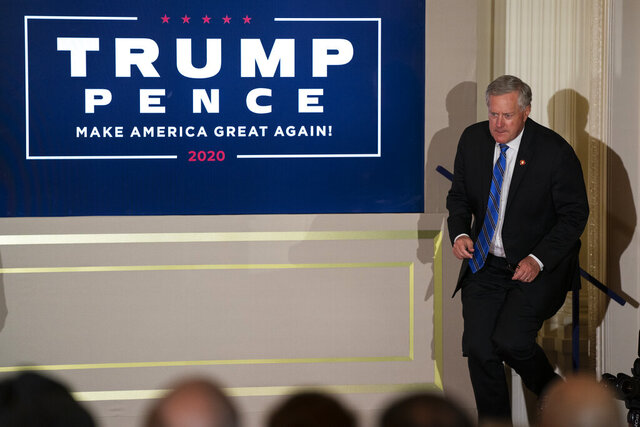 White House chief of staff Mark Meadows arrives to hear President Donald Trump speak on election night in the East Room of the White House, Wednesday, Nov. 4, 2020, in Washington. (AP Photo/Evan Vucci)