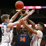 Cal State Fullerton guard Khalil Ahmad, center, and UC Irvine forward Tommy Rutherford, left, and guard Evan Leonard, right, vie for the ball during the first half of an NCAA college basketball game for the Big West men's tournament championship in Anaheim, Calif., Saturday, March 16, 2019. (AP Photo/Alex Gallardo)
