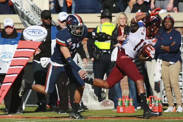 Virginia Tech wide receiver Tre Turner (11) is shoved out of bounds by Virginia safety Joey Blount (29) during the first half of an NCAA college football game in Charlottesville, Va., Friday, Nov. 29, 2019. (AP Photo/Steve Helber)