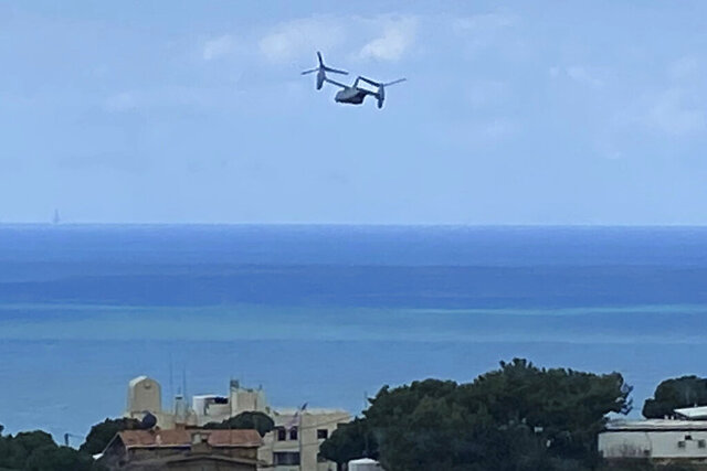 A U.S. Marine Osprey is seen taking off from the U.S. Embassy in Aukar, northeast of Beirut, Lebanon, Thursday, March 19, 2020. The aircraft took off a few hours before a U.S. senator announced that Lebanese-American Amer Fakhoury, who had faced decades-old murder and torture charges in Lebanon, was freed from a prison in Lebanon. Lebanese officials alleged that Fakhoury, 57, of Dover, New Hampshire, who had been jailed since September, was responsible for the killings and abuse of prisoners in Lebanon as part of an Israeli-backed militia two decades ago. (AP Photo/Zeina Karam)
