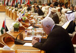 Palestinian President Mahmoud Abbas, foreground, attends an emergency summit of Gulf Arab leaders in Mecca, Saudi Arabia, Thursday, May 30, 2019. Saudi Arabia's King Salman opened an emergency summit of Gulf Arab leaders in the holy city of Mecca on Thursday with a call for the international community to use all means to confront Iran, but he also said the kingdom extends its hand for peace. (AP Photo/Amr Nabil)