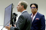 Defense attorney Lorne Berkeley, left, representing NFL free agent Antonio Brown addresses the court as defense attorney Eric Schwartzreich, right, listens during a first appearance hearing, Friday, Jan. 2,4 0202, at the Broward County Courthouse in Fort Lauderdale, Fla. Brown was granted bail on Friday after turning himself in at a Florida jail on charges that he and his trainer attacked the driver of a moving truck that carried some of his possessions from California.  (Amy Beth Bennett/South Florida Sun Sentinel via AP, Pool)