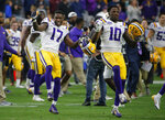 LSU wide receiver Racey McMath (17) and Stephen Sullivan celebrate after defeating UCF 40-32 during the Fiesta Bowl NCAA college football game, Tuesday, Jan. 1, 2019, in Glendale, Ariz. (AP Photo/Rick Scuteri)