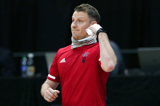 Nicholls State coach Austin Claunch watches during the first half of the team's NCAA college basketball game against Abilene Christian for the Southland Conference men's tournament championship Saturday, March 13, 2021, in Katy, Texas. (AP Photo/Michael Wyke)