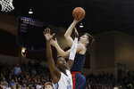 Gonzaga forward Filip Petrusev shoots as San Diego forward James Jean-Marie defends during the first half of an NCAA college basketball game Thursday, Jan. 9, 2020, in San Diego. (AP Photo/Gregory Bull)