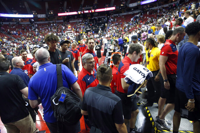 Players and staff leave the court after an earthquake during an NBA summer league basketball game between the New York Knicks and the New Orleans Pelicans on Friday, July 5, 2019, in Las Vegas. (AP Photo/Steve Marcus)