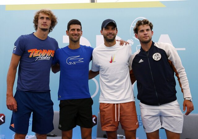 FILE - In this Friday June 12, 2020 file photo Serbia's Novak Djokovic, second left, poses with Germany's Alexander Zverev, left, Bulgaria's Grigor Dimitrov, second right, and Austria's Dominic Thiem after a press conference prior a a charity tournament Adria Tour, in Belgrade, Serbia. Novak Djokovic has tested positive for the coronavirus after taking part in a tennis exhibition series he organized in Serbia and Croatia. Grigor Dimitrov, a three-time Grand Slam semifinalist from Bulgaria, said Sunday he tested positive. (AP Photo/Darko Vojinovic)