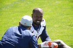 FILE - Denver Broncos outside linebacker Von Miller speaks to an unidentified person during an NFL organized training  session at the team's headquarters in Englewood, Colo., in this Tuesday, June 1, 2021, file photo. From players getting COVID-19 vaccinations to relaxed coronavirus protocols to lineup issues, the NFL faces a multitude of questions as training camps open. (AP Photo/David Zalubowski, File)