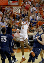 Texas guard Matt Coleman III (2) shoots a layup among three Xavier defenders during an NCAA college basketball game in the second round of the NIT on Sunday, March 24, 2019, in Austin, Texas. (Nick Wagner/Austin American-Statesman via AP)