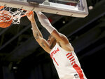 Dayton's Obi Toppin (1) dunks during the second half of an NCAA college basketball game against Fordham, Saturday, Feb. 1, 2020, in Dayton, Ohio. (AP Photo/Tony Tribble)