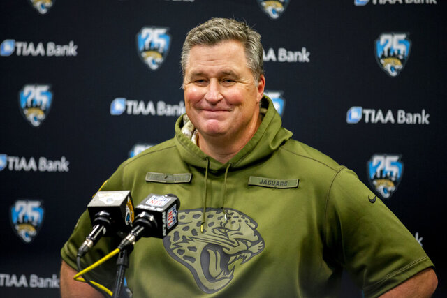 FILE - In this Dec. 29, 2019, file photo, Jacksonville Jaguars head coach Doug Marrone speaks with members of the media after the second half of an NFL football game against the Indianapolis Colts in Jacksonville, Fla. When the coronavirus pandemic forced everyone indoors — away from their everyday environments — creativity was the key. Marrone held weekly contests for his team, including a cooking competition last month with judging based solely on appearance and presentation. (AP Photo/Stephen B. Morton, File)