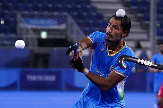 India's Dilpreet Singh (2) knocks the ball out of the air against Japan during a men's field hockey match at the 2020 Summer Olympics, Friday, July 30, 2021, in Tokyo, Japan. (AP Photo/John Locher)